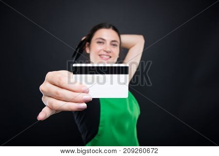 Supermarket Seller Holding Her Credit Card In Closeup