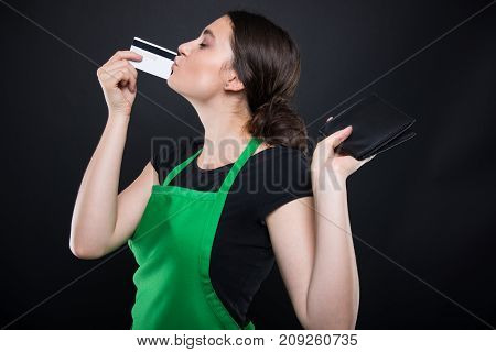 Young Woman Clerk Holding Credit Card
