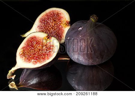 Figs, Half Of Figs On Black Background. Dieting Healthy Eating Concept.