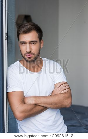Man Posing With Arms Crossed