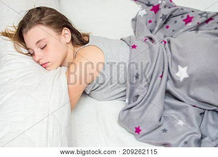 Beautiful Teen Girl Sleeping In Bed. Portrait.