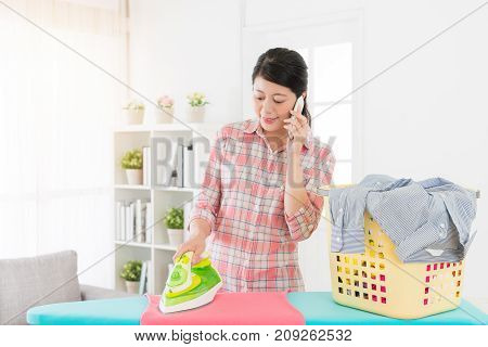 Smiling Happy Housewife Doing Housekeeping