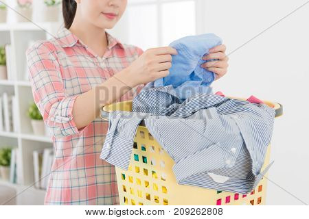 Housekeeper Woman Inspecting Clothing Clean