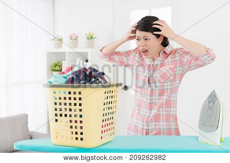 Unhappy Young Housewife Showing Shocked Emotional