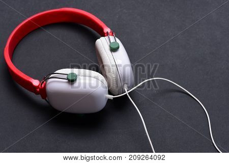 Headphones In White And Red Color With Long Wire