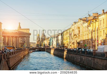 SAINT PETERSBURG RUSSIA - AUGUST 15 2017. Historic landmarks along the Griboedov channel in Saint Petersburg Russia. Architecture landscape of Saint Petersburg Russia in sunset