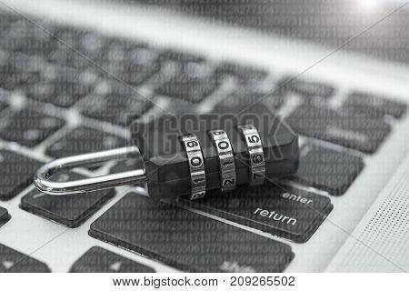 Closeup padlock on computer keyboard for concept technology data log security.