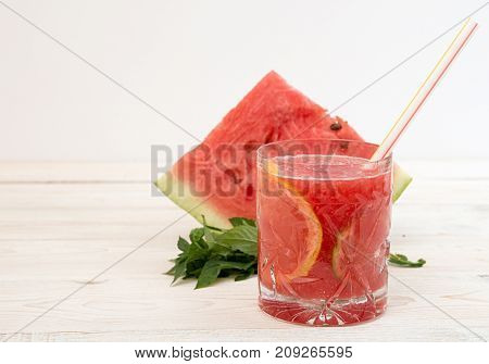 Summer Drink Watermelon Smoothie Juice In Glass With Cocktail Tube And Watermelon Slice On White Bac