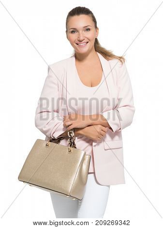 Portrait of an adult  smiling woman with handbag posing over white background