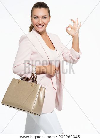 Portrait of aÑ? young adult  happy woman with okay gesture