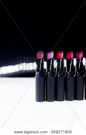 Set Of Matte Lipstick In Red And Natural Colors On White And Black Background. Fashion Colorful Lips