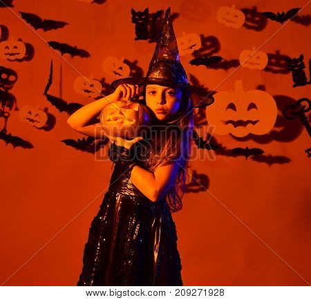 Girl With Proud Face On Orange Background With Decor