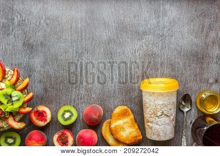 Ingredients for oatmeal on dark wooden table. Concept of healthy food. Top view, copy space. Flat lay. Still life.