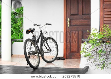 Modern bicycle near house at resort