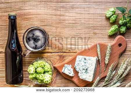 Beer background. Fresh beer and the salty cheese on a wooden table. Top view. Still life. Flat lay.