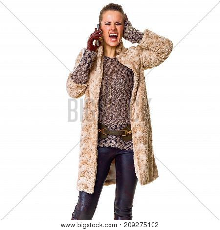 Stressed Young Fashion-monger On White Speaking On Mobile Phone