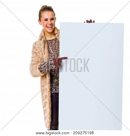 Happy Trendy Woman On White Pointing At Blank Board