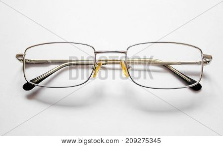 Glasses on a white background as a new idea