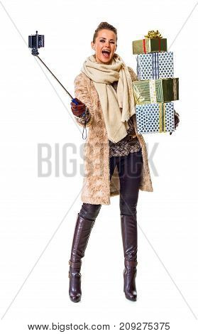 Woman With Pile Of Christmas Present Boxes Taking Selfie Using Selfie Stick