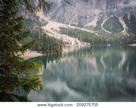 View to beautiful calm lake in forest in mountains.