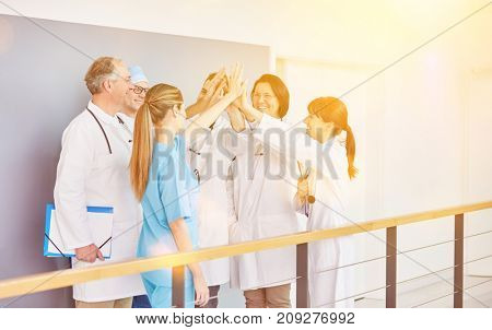 Doctor or physician High Five team for motivation