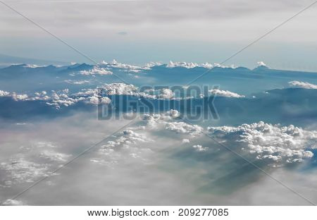 Beautiful Clouds And Mountains Landscape View From Airplane