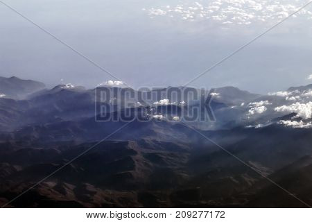 Beautiful mountain shapes landscape view from airplane height
