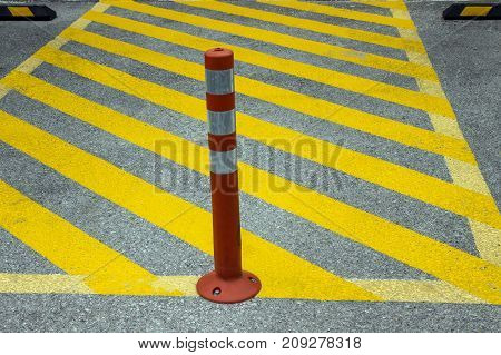 Display of parking prohibition. Red pillar with stripes.