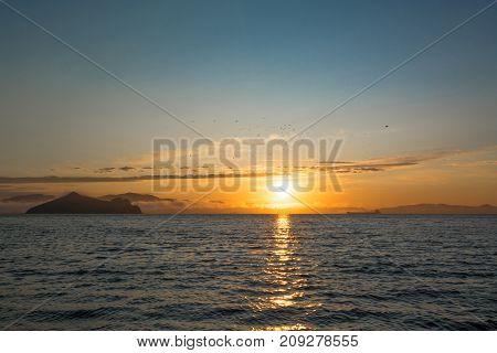 Orange Dawn And Dark Water. Early Morning On The Sea Coast.