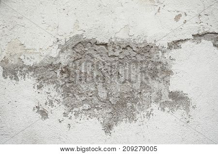 Background and texture of rough and broke white cement wall.