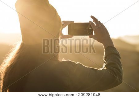 Woman taking a picture with her cellphone