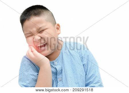 Obese asian fat boy suffering from toothache isolated on white background - Dental problem.