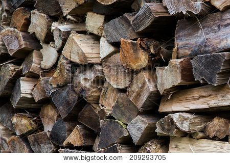 Preparation Of Firewood For The Winter. Firewood Background. Pile Of Firewood.