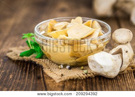 Fresh Made Canned Porcinis On A Rustic Background