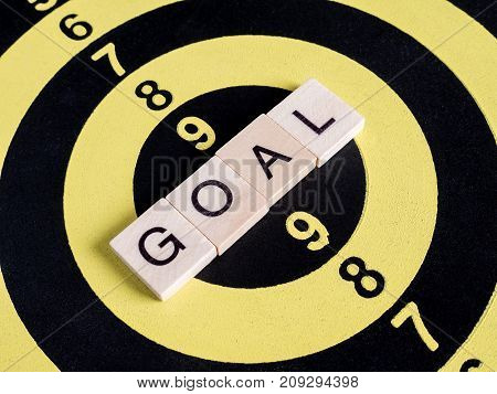 Closeup of word spell Goal on dart board (Business Concept)