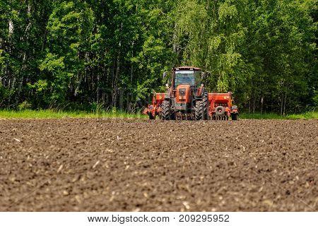 Farmer Seeding Crops At Field