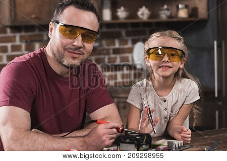 Father And Daughter Posing While Brazing
