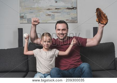 Father And Daughter Showing Muscles