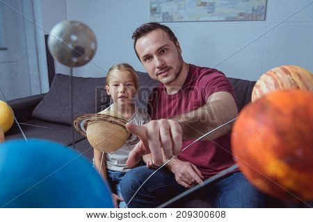 Father Showing Daughter A Planet