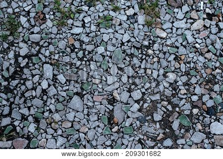 Stones on the ground, background and texture in the form with a rocky surface on top. Gravel in the summer on the site.