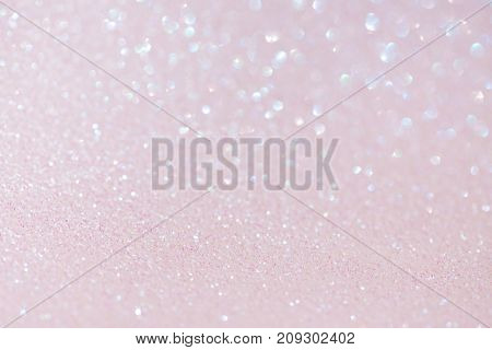 light pink festive background with sparkles in the bokeh. The concept of the celebration, the day of St. Valentine, New Year, birthdays, ceremonies, events, etc.