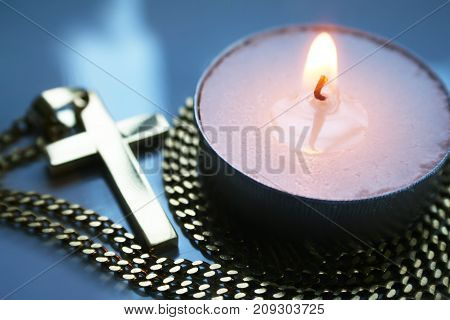Religious Golden Cross Next To Candle High Quality