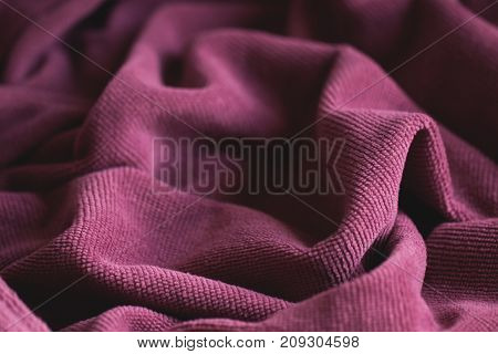 Soft velvet texture. Delicate pink color. The concept of femininity, home comfort, warmth