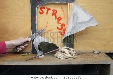 Artist in stress cutting his artwork with knife outdoor cropped photo