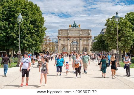PARIS,FRANCE - JULY 29,2017 : Locals and tourists at the Tuileries Garden on a summer day in Paris