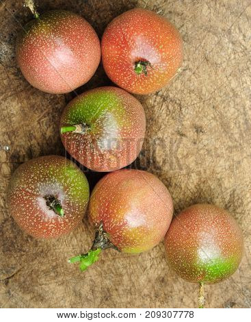 Fresh Passion fruits on old wooden background.