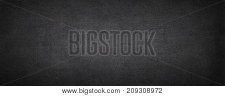 Black chalkboard. Dark concrete background. Black stone banner