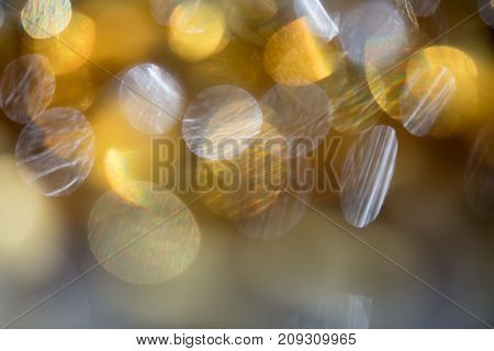 Golden yellow bokeh light defocused abstract background with copy space