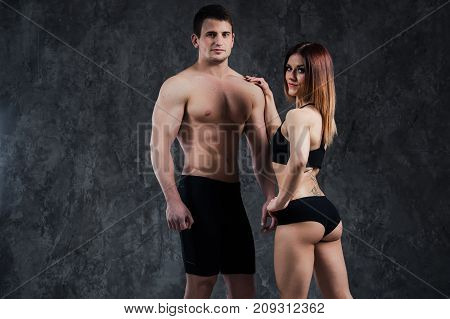 athletic beautiful sexy young couple posing in studio.