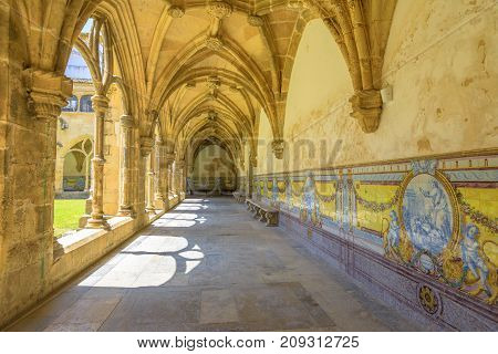 Colonnade with Azulejos of Santa Cruz Monastery. The Church of Santa Cruz is one of the most fascinating religious buildings of Coimbra which was given the status of the National Pantheon of Portugal.